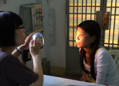 Ms Vinh doing regular check up with patient